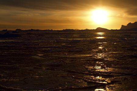 antarctic peninsula: winter southern ocean near the Antarctic Peninsula in the sunset