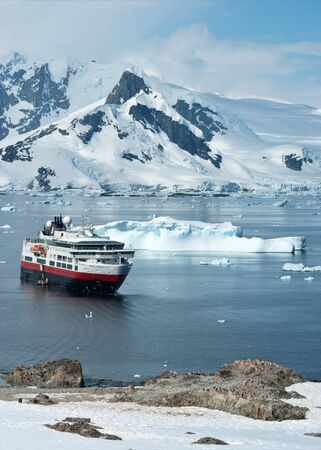 penguin colony: tourist ship that stands in the strait near the penguin colony