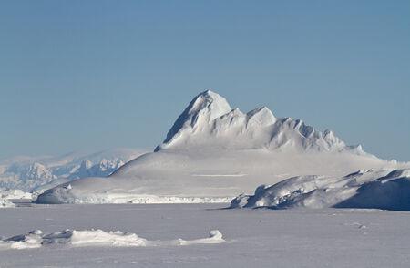 Pyramid prominent iceberg frozen in winter Antarctic waters Фото со стока