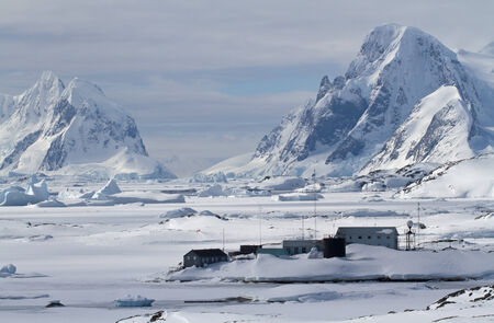 polar station: Scientific Antarctic station winter day on a background of mountains