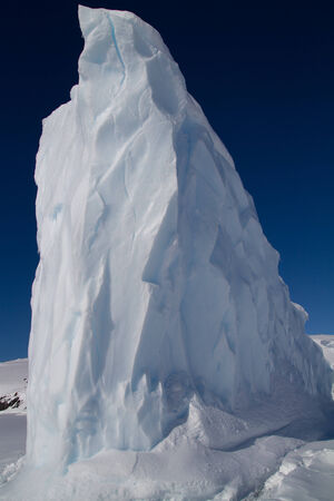 tip of iceberg: tip of the iceberg in Antarctic waters frozen winter day