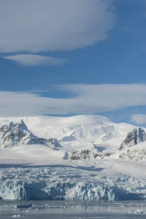 ice floe: glaciers and mountains on the coast of the Antarctic Peninsula sunny day