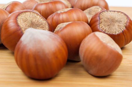 Handful of hazelnuts on wooden background Stok Fotoğraf