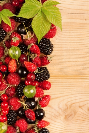 Ripe Berries on Wooden Background photo