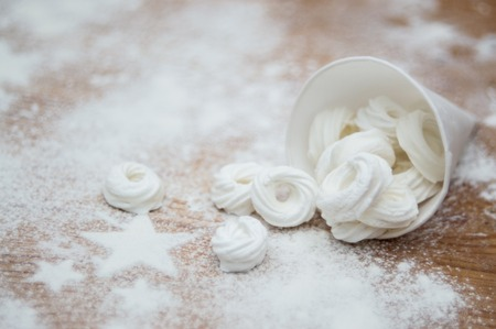 Christmas interior with meringue rings and icing sugar stars Stok Fotoğraf