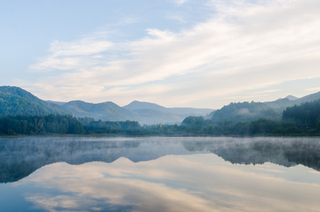 Morning lights above the lake in the Transylvanian mountains 版權商用圖片