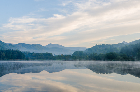 Morning lights above the lake in the Transylvanian mountains Banque d'images