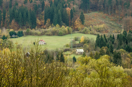Little traditional peasant cabin in the mountains Europe, Slovakia surrounded with autumn color forest and meadow