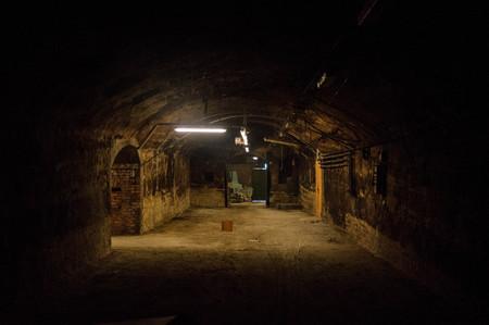 Scene from an old abandoned cellar - Halloween background - European underground interior