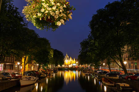 excursions: Amsterdam,  Netherlands - July 31, 2014: The famous Amsterdam canals at night. Popular places for walks and excursions.
