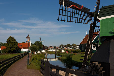Amsterdam,  Netherlands - August 4, 2014:  Windmills of Holland. A large complex of museum of old windmills. Tourist Attractions. photo