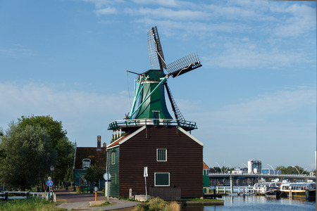 Amsterdam,  Netherlands - August 4, 2014:  Windmills of Holland. A large complex of museum of old windmills. Tourist Attractions.