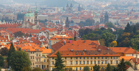 Prague, Czech Republic. Views over Prague from the Petrin hill height. The highest point over Prague. Red tiled roofs of the old town. Vltava River with bridges. photo
