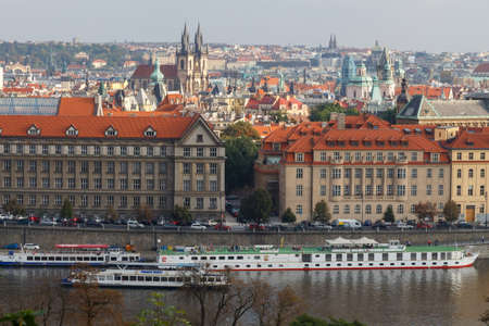 excursions: Prague, Czech Republic - October 3, 2014: View from the heights of Prague and the Vltava River Promenade. Excursions on the Vltava River on tourist ships. Editorial