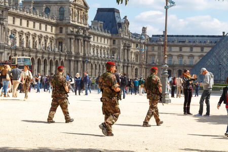 stringent: Paris, France - May 3, 2014: A patrol of soldiers in the yard the Louvre. France adopted stringent measures to combat crime and terrorism. Editorial