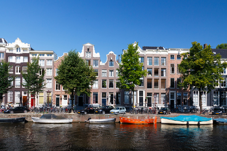 typically dutch: Amsterdam, Netherlands - August 5, 2014: Canals of Amsterdam. Favorite place for walking and leisure travelers.
