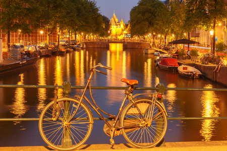 typically dutch: Amsterdam, Netherlands - July 31, 2014: Canals of Amsterdam. Favorite place for walking and leisure travelers.