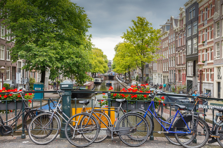 Amsterdam, Netherlands - August 6, 2014: Canals of Amsterdam. Favorite place for walking and leisure travelers.
