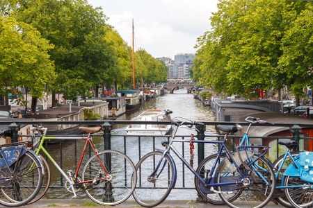 Amsterdam, Netherlands - July 29, 2014: Canals of Amsterdam. Favorite place for walking and leisure travelers.