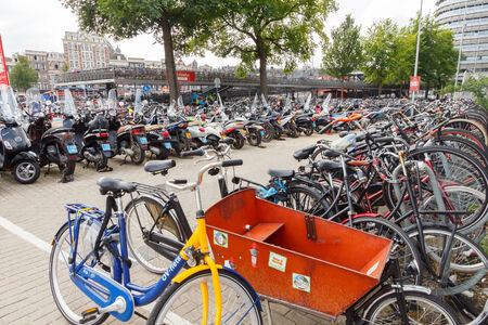 traditionally dutch: Amsterdam, Netherlands - July 29, 2014: Bicycle parking in Amsterdam a large near the central station. Editorial