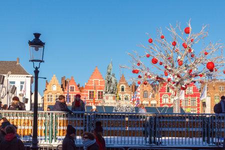bruges: Bruges, Belgium - December 28, 2014: Decorated Christmas ice rink and the central square in Bruges. Market Square.