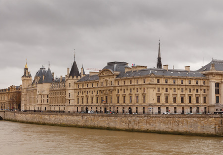 Paris, France - December 19, 2014: The building of the Conciergerie and Pont Neuf in a  gloomy winter day.