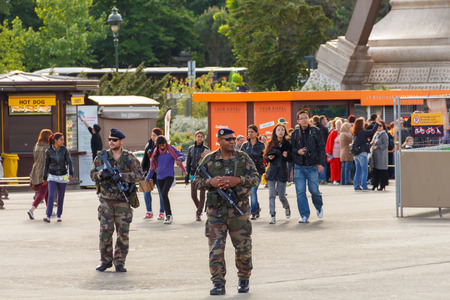 berets: Paris, France - May 9, 2014: French Marines patrol near the Eiffel Tower.