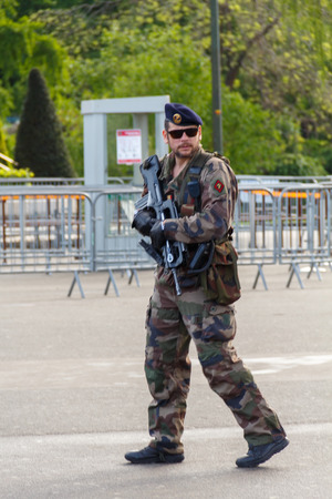 Paris, France - May 9, 2014: French Marines patrol near the Eiffel Tower.