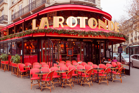 Paris, France - December 22, 2014: Famous bohemian Parisian Cafe La Rotonde. Located not far from the Montparnasse Tower. Editöryel