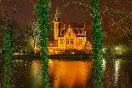 tourist destinations: Bruges, Belgium - December 26, 2014: Old park Minnewater in Bruges. One of the favorite tourist destinations and townspeople.