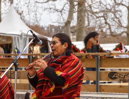 entertain: Paris, France - December 20, 2014: Street musicians entertain tourists on the Champ de Mars in Paris.