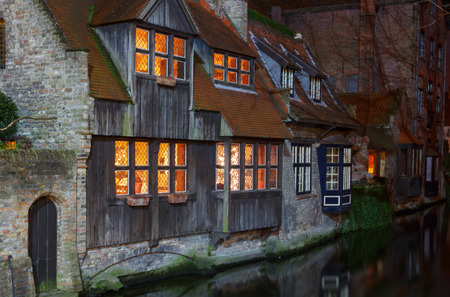 bruges: Old house on the canal at night in Bruges