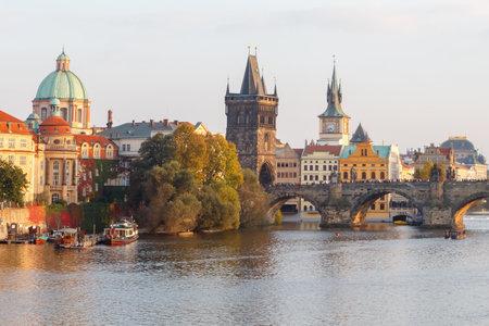excursions: Prague, Czech Republic - October 3, 2014: View of Prague and the Vltava River Promenade. Excursions on the Vltava River on tourist ships.