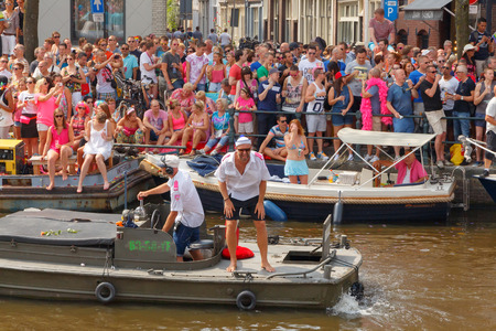 canal parade: Amsterdam, Netherlands - August 2, 2014:  participants in the annual event for the protection of human rights and civil equality. Editorial