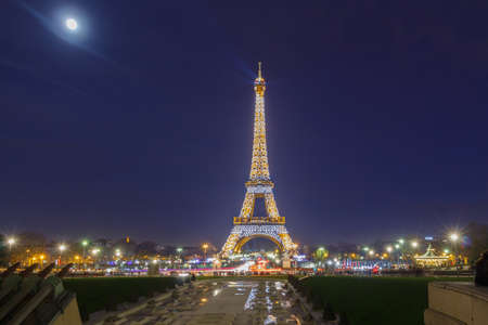 trocadero: Paris, France - January 1, 2015: Eiffel Tower with electric lighting in the late evening. The tower is the most famous and popular tourist attraction in Paris.