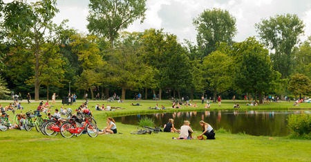 Amsterdam, Netherlands - August 5, 2014: Vondelpark a favorite place for rest and walking residents and tourists. People sit, eat, To Meet Just on the lawns.