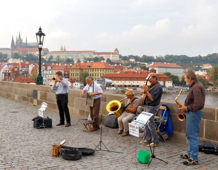 Prague, Czech Republic - October 1, 2014: presentation by of street musicians on the Charles Bridge. Charles Bridge is one of the most famous sights of the Czech capital.