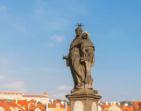 st charles: Statue of St. Anthony of Padua on Charles Bridge in Prague. Made in the 16th century.