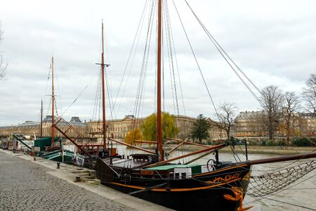 bowsprit: Paris, France - December 20, 2014: Vintage sailing ships along the River Seine. Favorite place for walking tourists and residents.