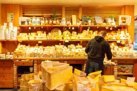 Paris, France - December 22, 2014: French cheese shop with many kinds of cheeses. French cheese is one of the most popular foods in the country.