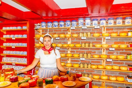 Amsterdam, Netherlands - July 30, 2014: Shop with the famous Dutch cheeses. Cheese - a traditional Dutch product. Редакционное