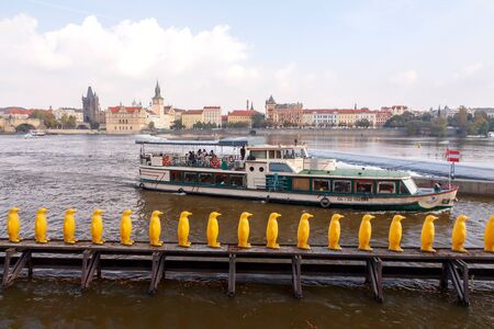 excursions: Prague, Czech Republic - October 2, 2014: View from the heights of Prague and the Vltava River Promenade. Excursions on the Vltava River on tourist ships. Editorial
