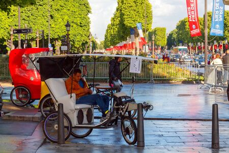 champs elysees: Paris, France - May 11, 2014: Cyclists on the Champs Elysees in Paris on a spring morning.