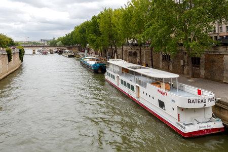 dinghies: Paris, France - May 7, 2014: Promenade along the river Seine near the Ile de la Cit? in Paris. Dinghies near the waterfront.