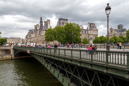 sita: Paris, France - May 7, 2014: Hotel-de-Ville (City Hall) in Paris - an office building in the center of Paris. Bridge over the River Seine on Cite island.