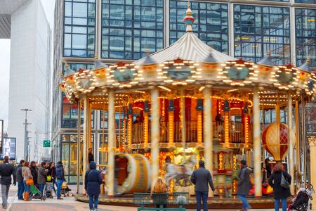 december 21: Paris France  December 21 2014: Traditional French carousel in the area of La Defense. Paris.