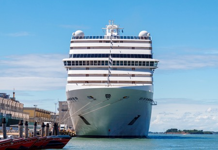 ocean liner: Venice Italy May 24 2015: Big cruise ship docked in the port of Venice. Journey on an ocean liner is one of the most attractive and userfriendly entertainment.