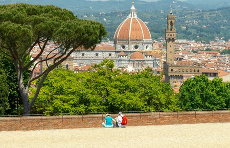 Tourists admire the view of Florence from Fort Belvedere. Stock Photo