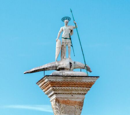 theodore: The sculpture of St. Theodore on the top of the west tower Piazzetta San Marco Venice Italy.