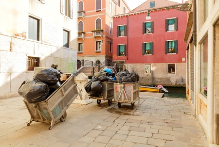specificity: Venice Italy May 24 2015: The collected garbage in the morning waiting for loading on a special barge. In Venice you can to take out the trash only waterway.